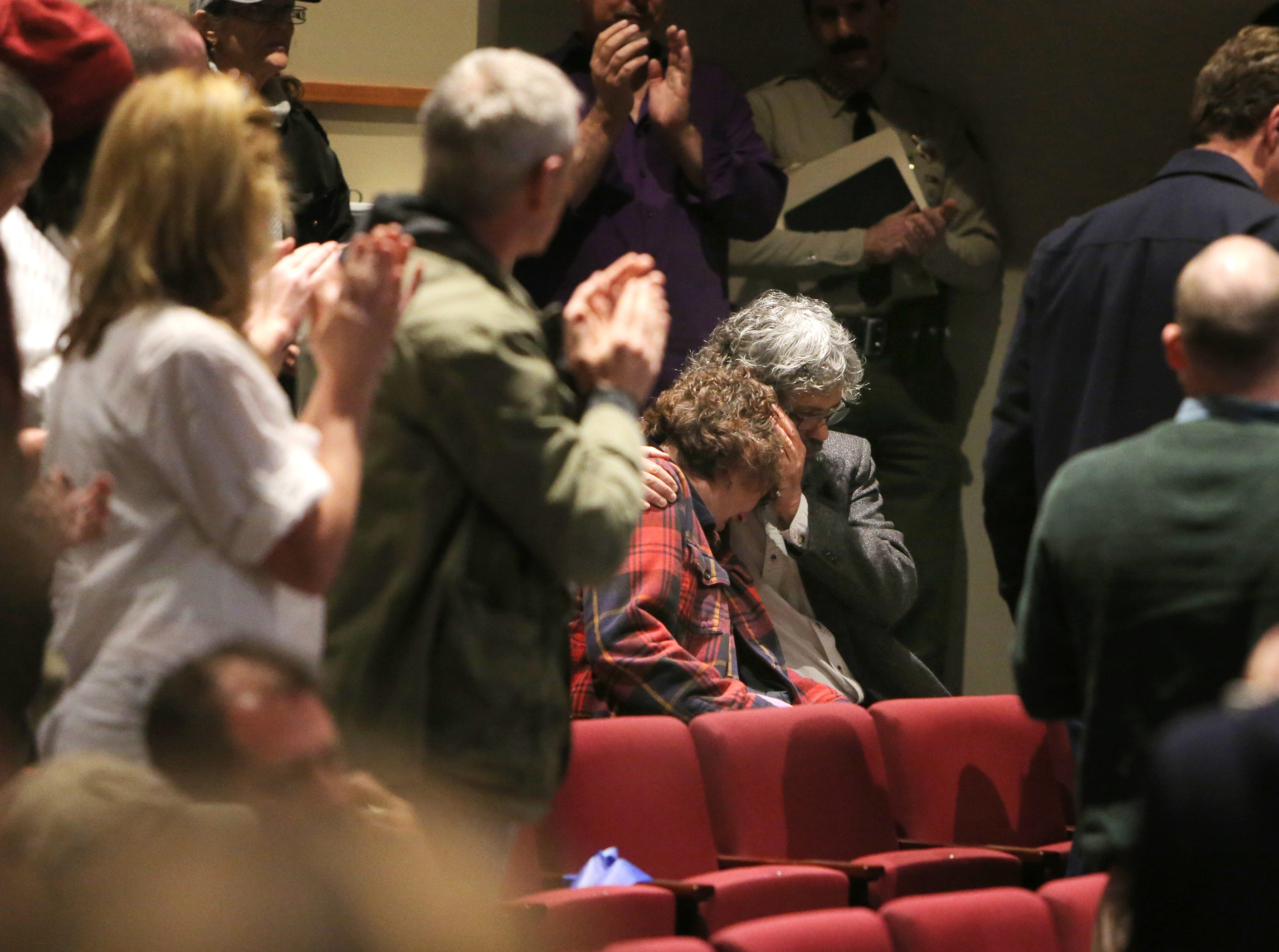 Marc Orfanos consoles his wife, Susan, after she spoke about their son Telemachus Orfanos during a forum on  gun violence Sunday at Westlake High School. Telemachus Orfanos was among the victims of the shooting at Borderline Bar & Grill in Thousand Oaks.