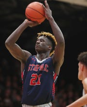 Stepinac's Adrian Griffin Jr. puts up a shot against Iona during basketball action at Iona College in New Rochelle Feb. 2, 2019. Stepinac won the game 65-59.
