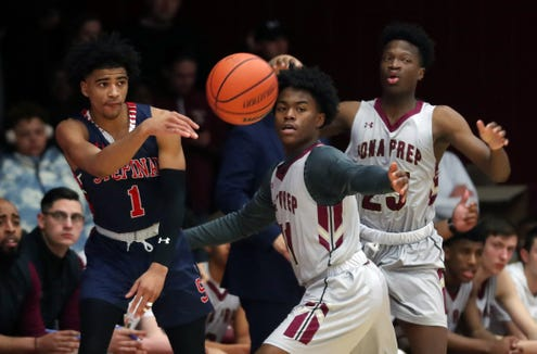 Stepinac's R.J. Davis (1) passes around Iona's Marquis Dukes (11) during  basketball action at Iona College in New Rochelle Feb. 2,  2019.