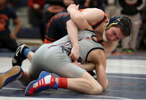 Horace Greeley's Matthew Schreiber on his way to defeating Ketcham's Dylan Glickman in the 106-pound weight class during the divisional qualifier at Horace Greeley High School in Chappaqua Feb. 2, 2019.
