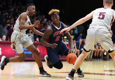 Stepinac's Adrian Griffin Jr. drives to the basket against Iona during basketball action at Iona College in New Rochelle Feb. 2, 2019. Stepinac won the game 65-59.