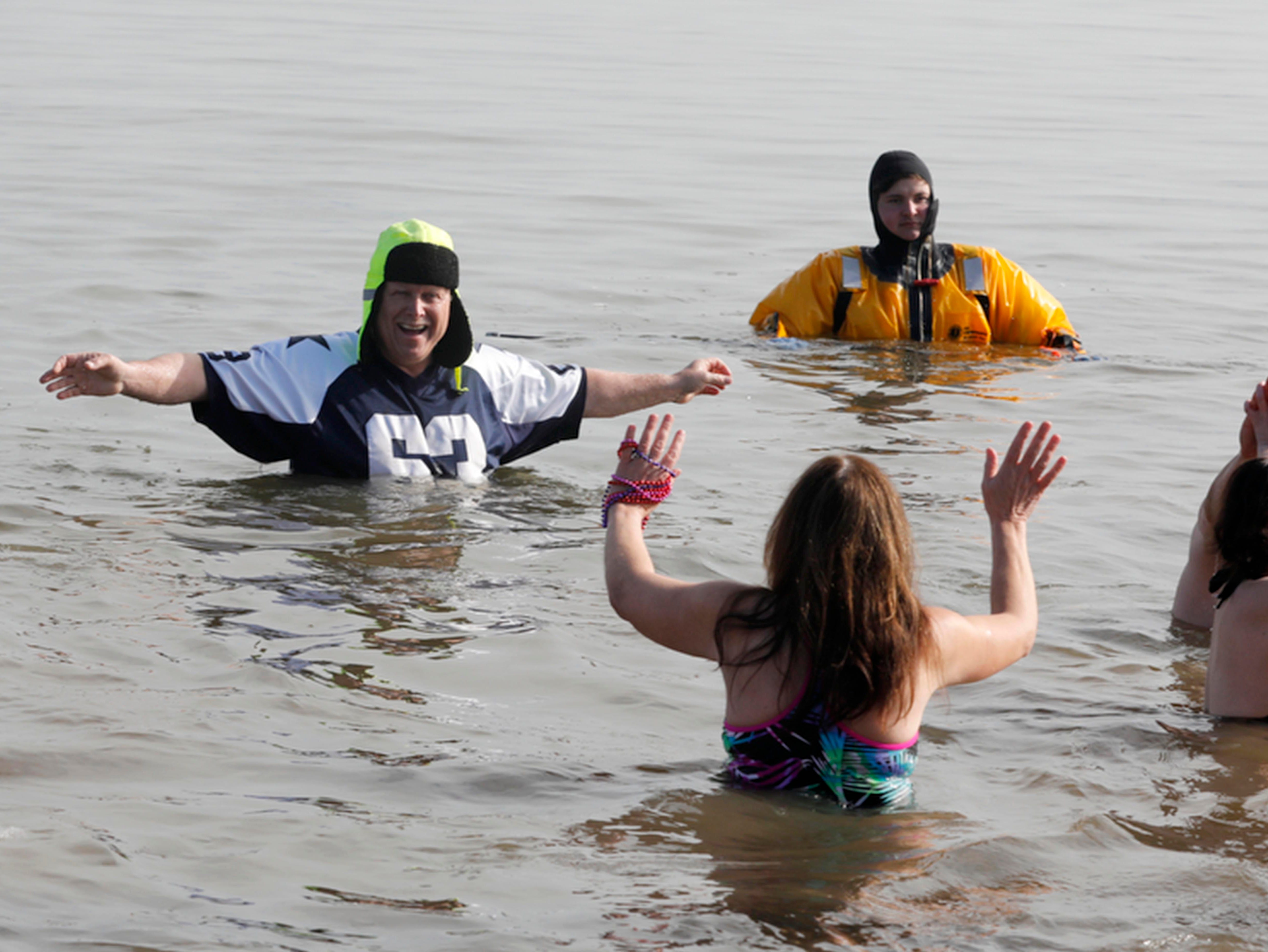 Over one-hundred participants splash around way in the Hudson River in Stony Point Feb. 3, 2019 for the 20th Stony Point Seals Annual Plunge. The annual event is a fundraiser for local individuals in the need of the community's support. This year's event raised money for two local children who are dealing with serious health issues. The event included music, food, raffles, and donated prizes.
