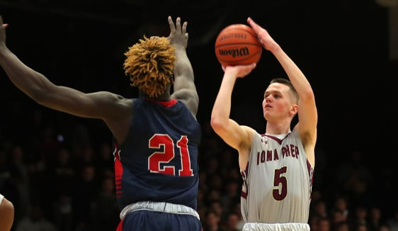 Iona's Aidan Hildebrand (5) puts up a shot in front of Stepinac's Adrian Griffin Jr. during basketball action at Iona College in New Rochelle Feb. 2,  2019.