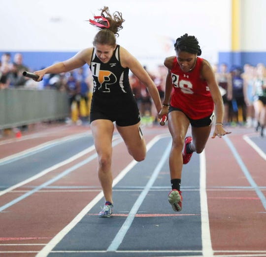 Smyrna's Kelly Barr (right), shown last year at the DIAA Indoor meet, won the Girls Varsity A race at the Lake Forest Invitational last Saturday and led a sweep of the top four positions by the Eagles.