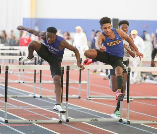 Caesar Rodney's Leon Jett (right) edges Middletown's Brahmir Vick for first place in the 55-meter hurdles during the DIAA state indoor track championships in Landover, Md.