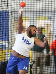 Bradly Anyanwu of Dover takes the state title in shot put, the lone individual win his team had en route to the team championship during the DIAA state indoor track championships in Landover, Md. Saturday.