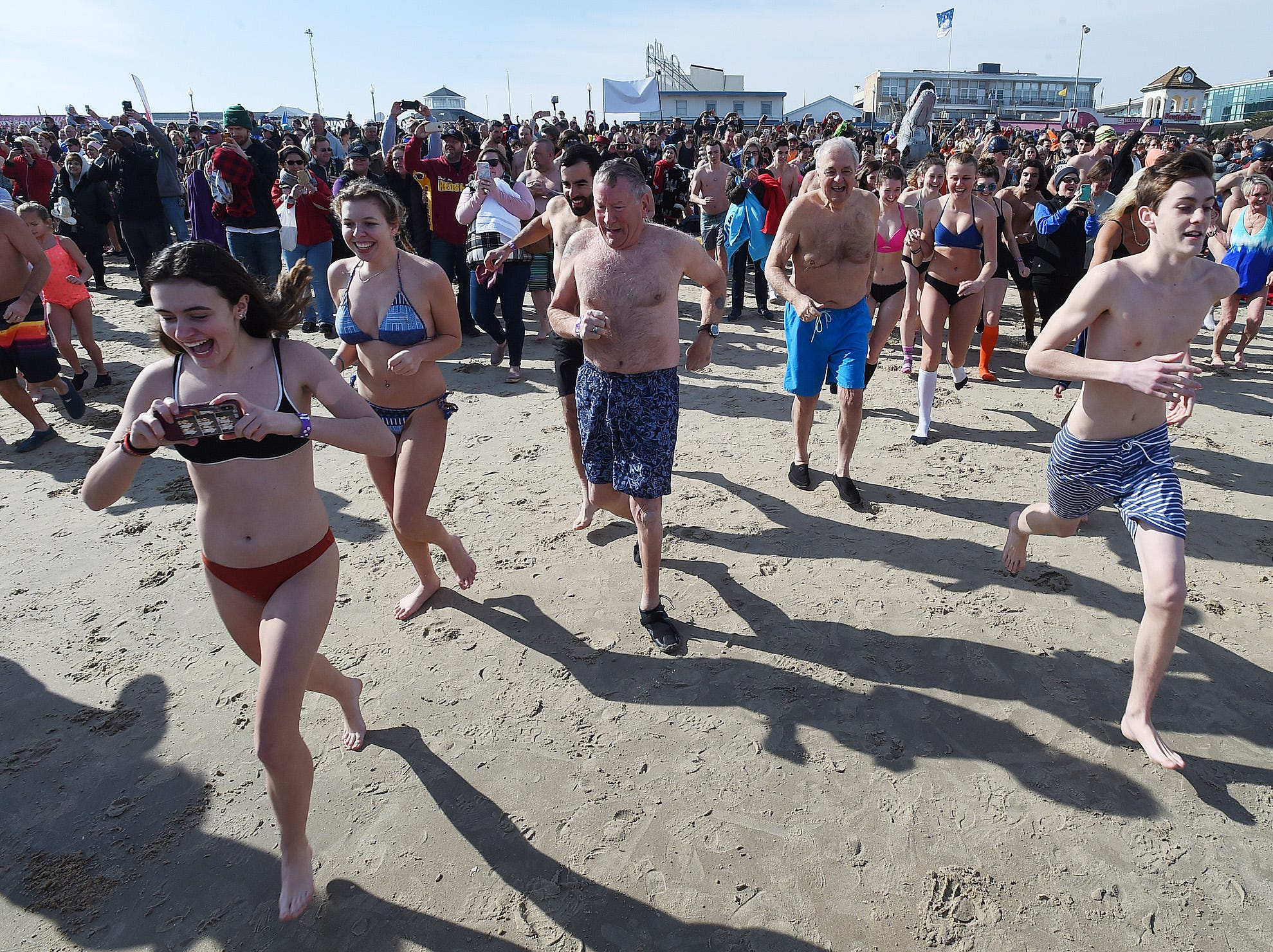 "Warmer temperatures had over 3000 ""Bears"" making the jump into the Atlantic Ocean on Sunday for the Annual Lewes Polar Bear Plunge for Special Olympics Delaware on the beach at Rehoboth Beach.  Special to the News Journal / CHUCK SNYDER"