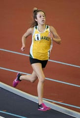 St. Mark's Tiffany Herrera, shown here winning the girls 3,200 meters at last year's DIAA Indoor meet, won the varsity blue division race at the Nike Great American Cross Country Race on Saturday in Cary, North Carolina.