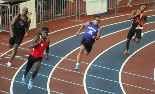 Smyrna's Raymond Nyameke (bottom) heads through the final turn of the 200 meter dash with the lead on the way to winning, ahead of (from left) William Penn's KeShawn Dennis , Middletown's Bryce Pepukayi (2nd place) and A.I. du Pont's Zahmeire Lewis  during the DIAA state indoor track championships in Landover, Md. Saturday.