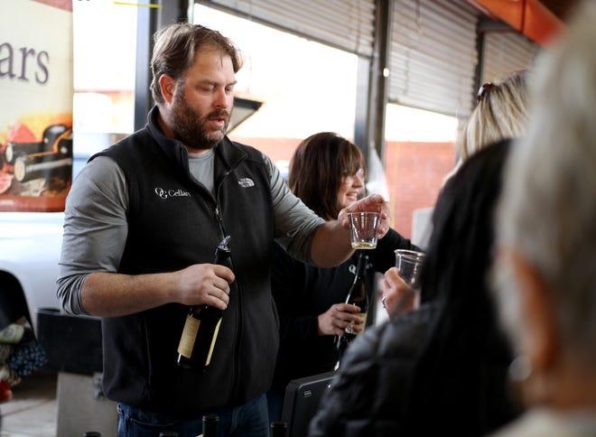 OG Cellers' James Hanger pours wine samples Saturday, Feb. 2, 2019, at the Wichita Falls Farmer's Market.