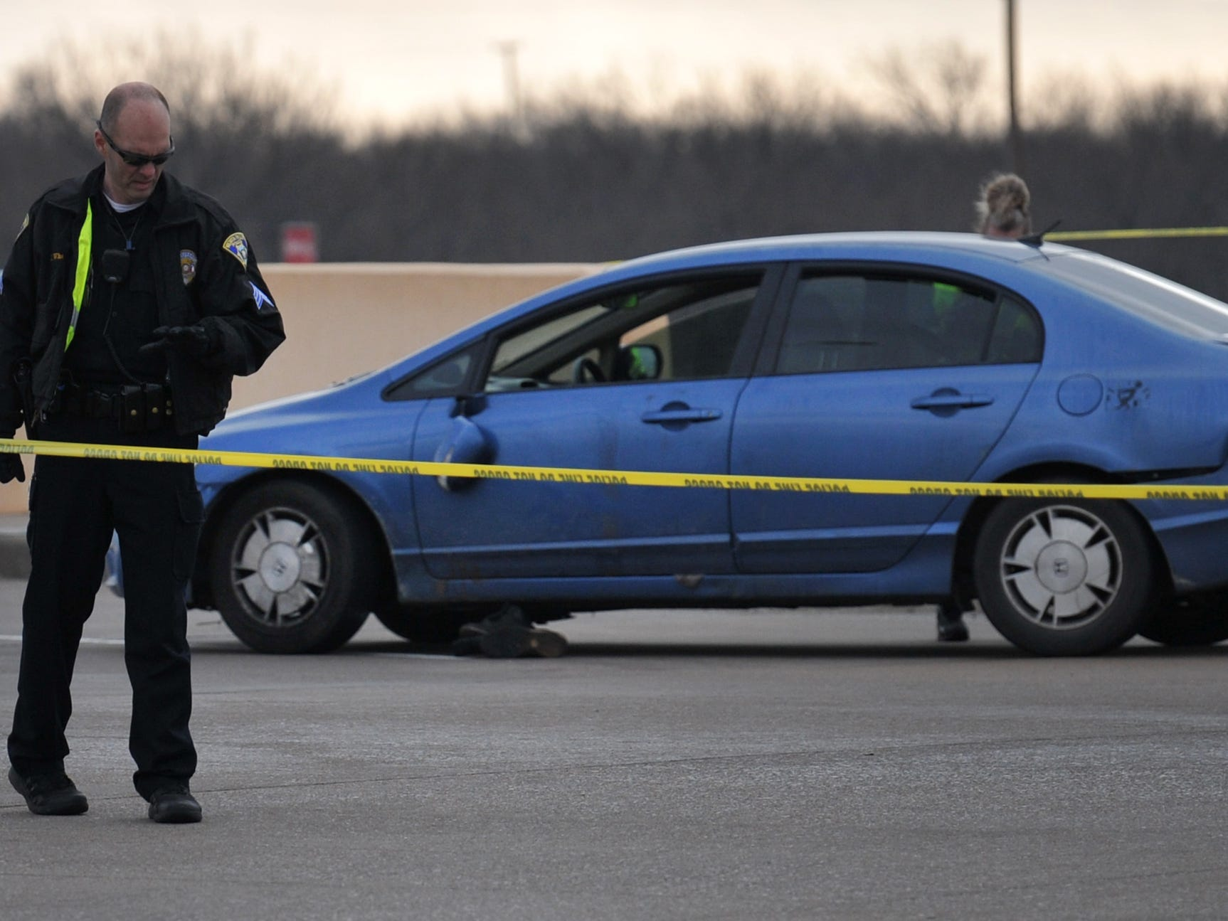 Wichita Falls police investigate the scene of an officer-involved shooting near the Airport Road at Central Freeway Access Road intersection early Sunday morning.
