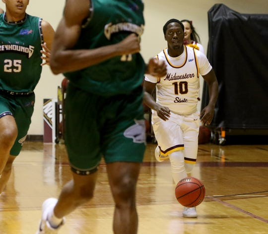 Midwestern State's Terrell Wilson dribbles in the game against Eastern New Mexico Saturday, Feb. 2, 2019, in D.L. Ligon Coliseum at MSUTexas.