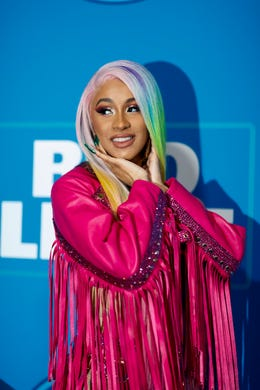 Cardi B is seen on the blue carpet before performing on Super Bowl eve.