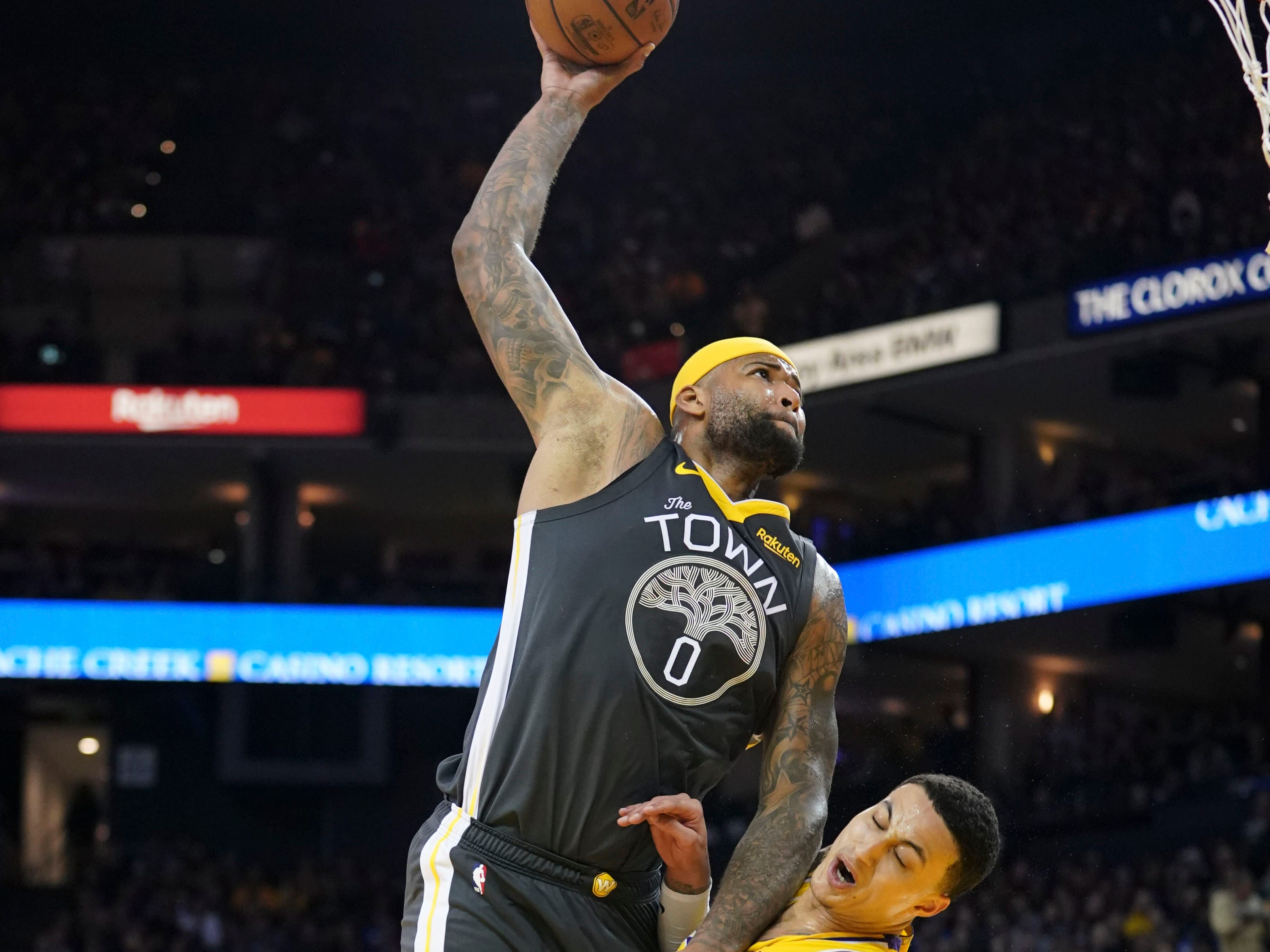 Feb. 2: Warriors center DeMarcus Cousins destroys Lakers defender Kyle Kuzma with a monster one-handed slam at Oracle Arena in Oakland.