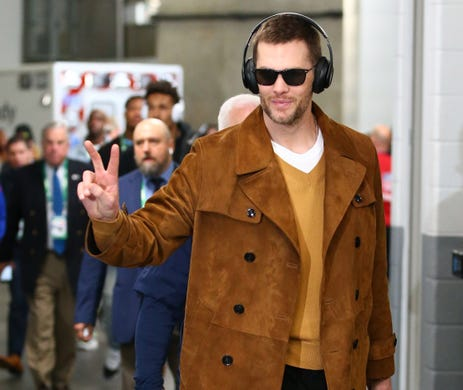 New England Patriots quarterback Tom Brady arrives before Super Bowl LIII.