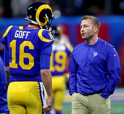 Los Angeles Rams head coach Sean McVay, right, talks with quarterback Jared Goff (16) before Super Bowl LIII against the New England Patriots.