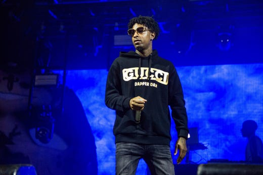 FILE - In this Sunday, Oct. 28, 2018, file photo, 21 Savage performs at the Voodoo Music Experience in City Park in New Orleans. Authorities in Atlanta say Grammy-nominated rapper 21 Savage is in federal immigration custody. U.S. Immigration and Customs Enforcement spokesman Bryan Cox says the artist, whose given name is Sha Yaa Bin Abraham-Joseph, was arrested in a targeted operation early Sunday, Feb. 3, 2019, in the Atlanta area. (Photo by Amy Harris/Invision/AP, File) ORG XMIT: NYSB772