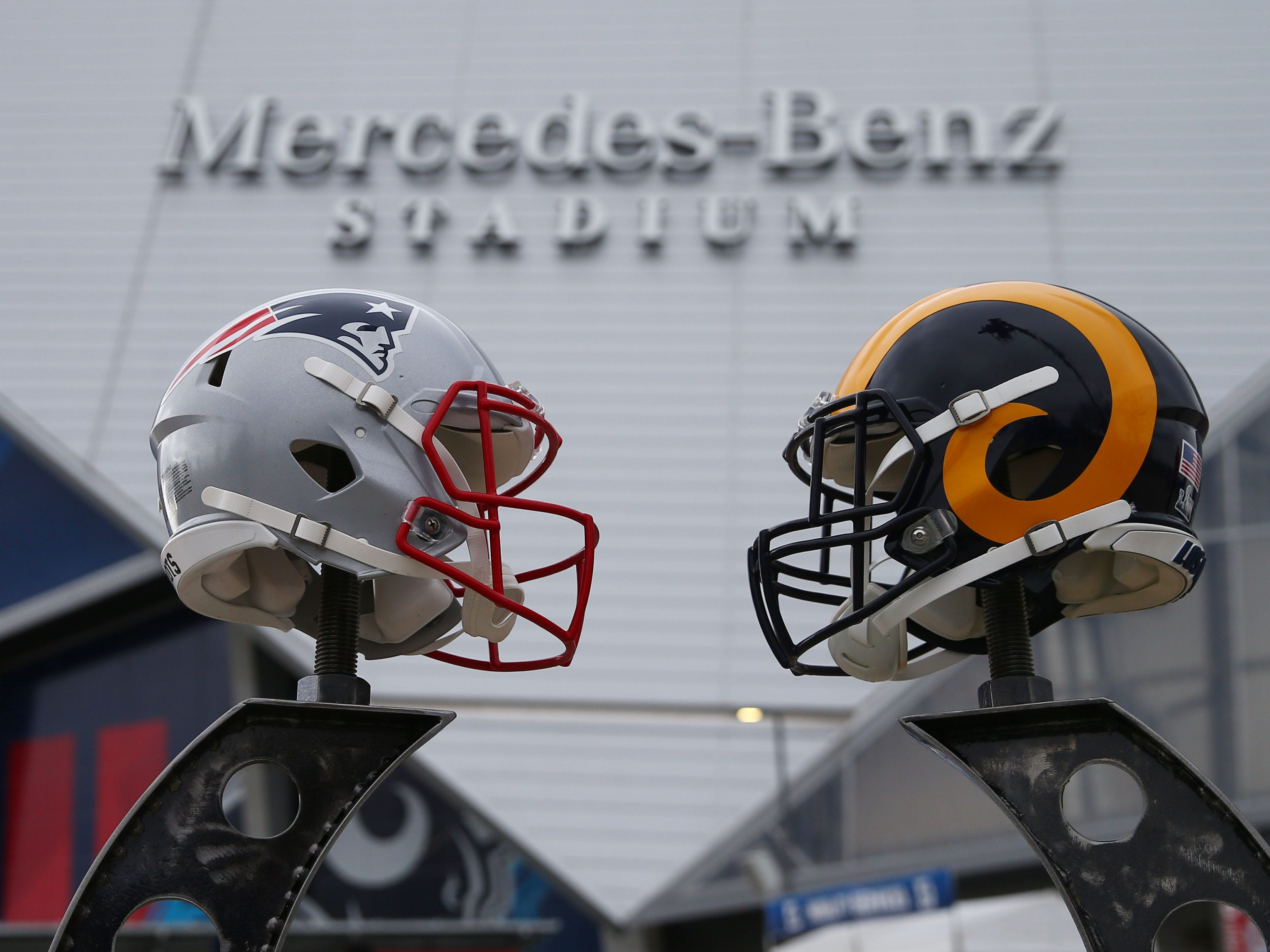 Helmets for the Patriots and Rams on display before Super Bowl LIII outside Mercedes-Benz Stadium.
