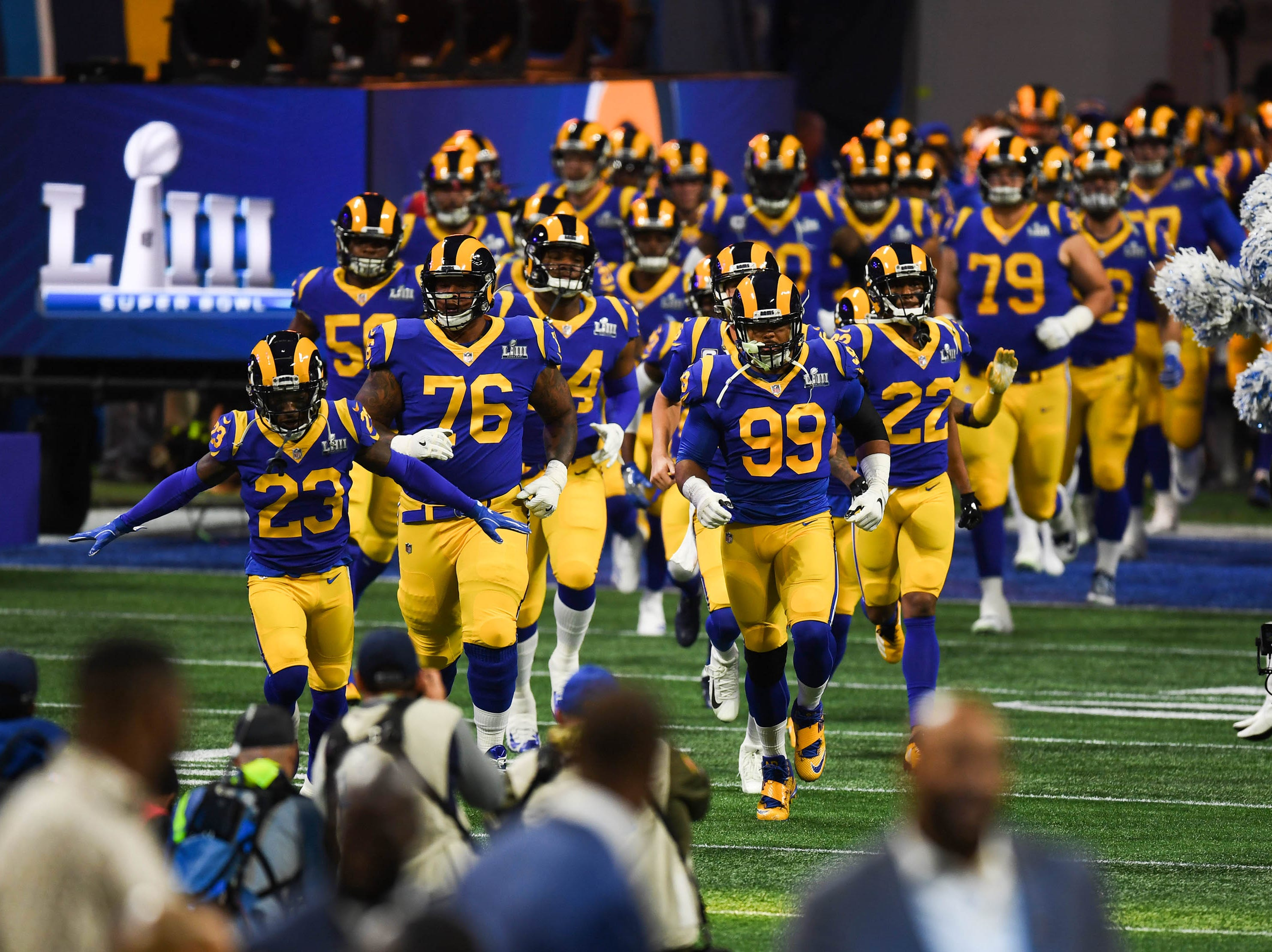 Los Angeles Rams players take the field for Super Bowl LIII against the New England Patriots at Mercedes-Benz Stadium.
