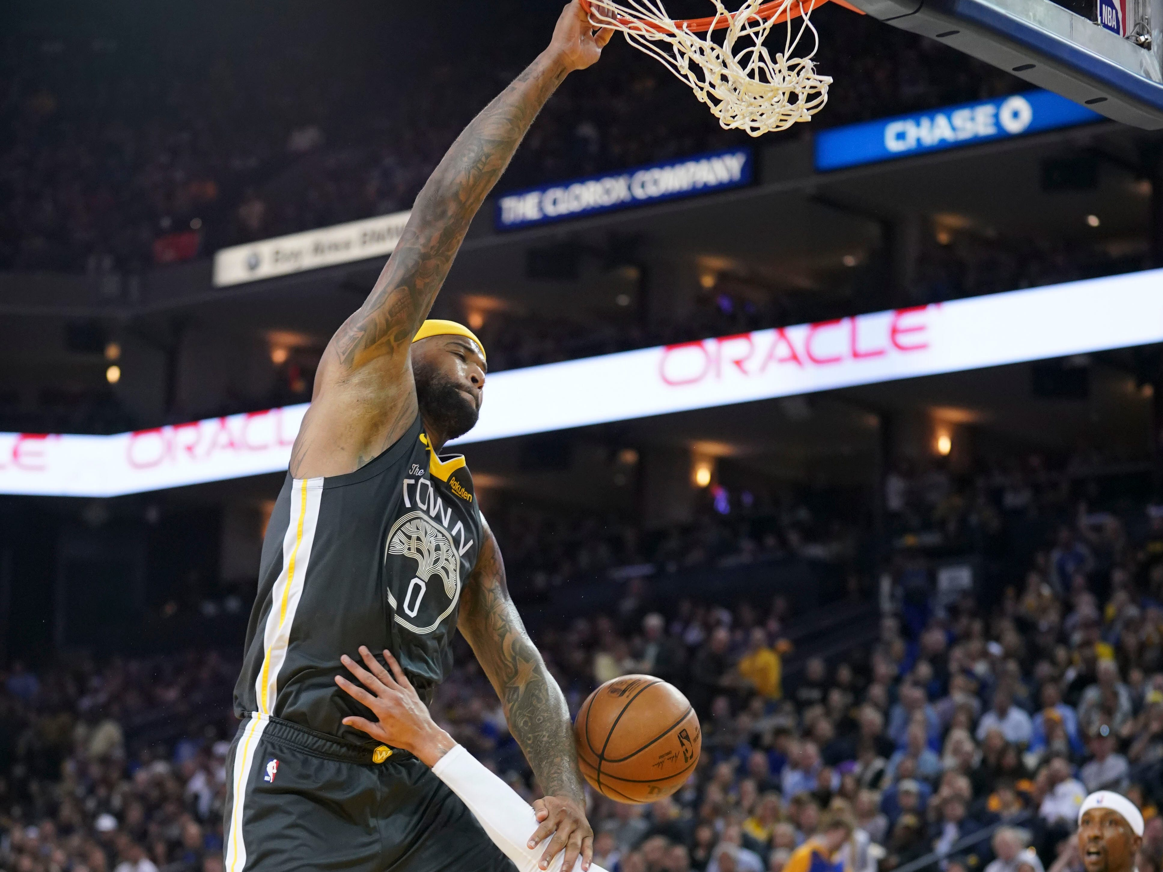 Feb. 2: Warriors center DeMarcus Cousins sends the Oracle Arena crowd into a frenzy with a huge one-handed slam over Lakers defender Kyle Kuzma.