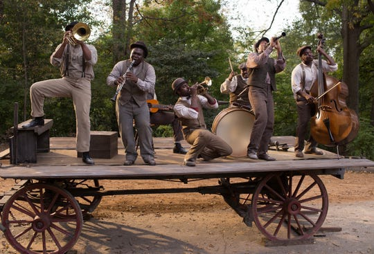 "Buddy Bolden (Gary Carr, center) performs with his band in the movie ""Bolden."""