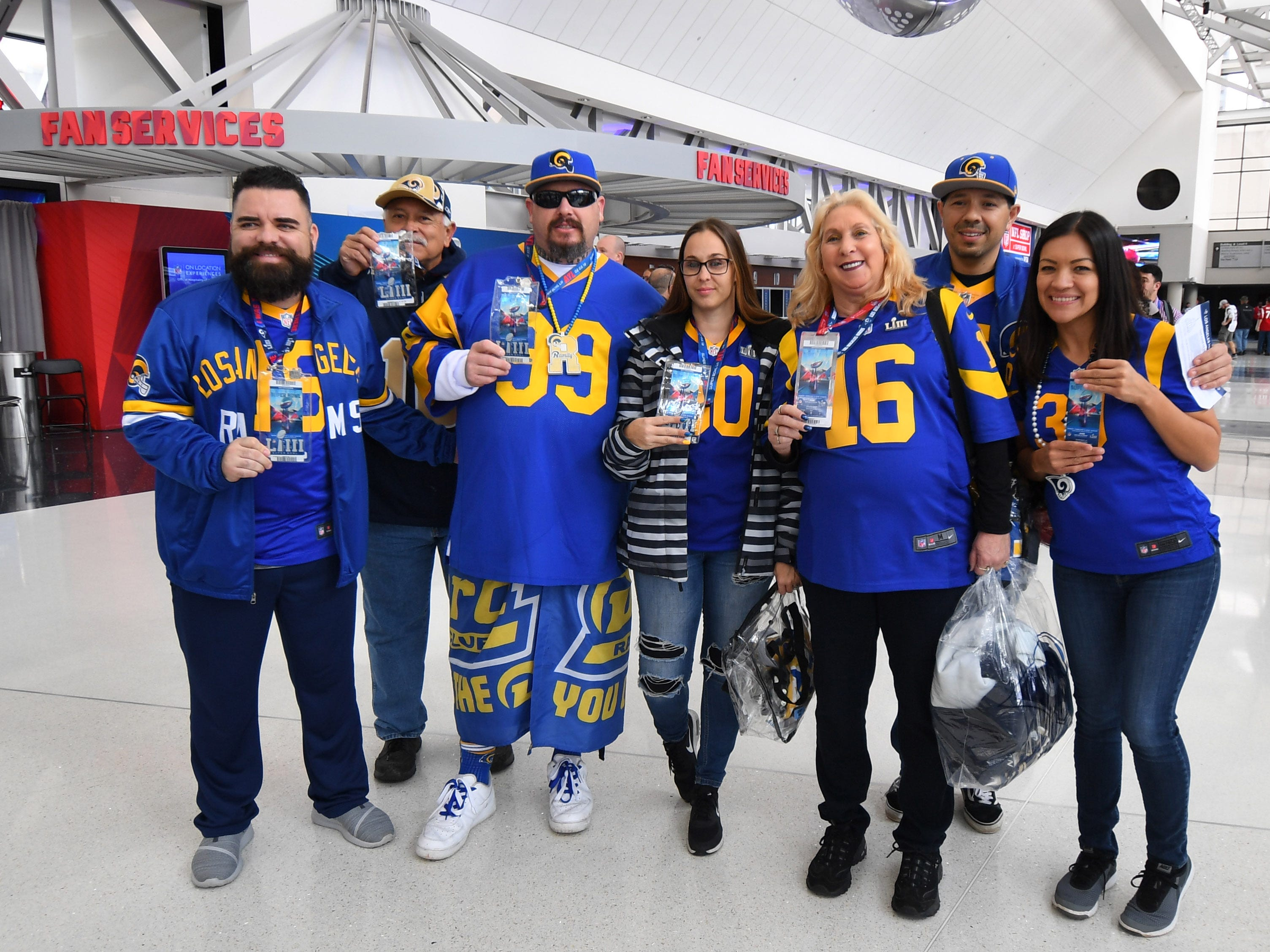 Rams fans pose for a photo before Super Bowl LIII.