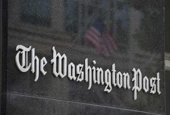 (FILES) This August 6, 2013, file photo shows a sign outside of The Washington Post building in DC.