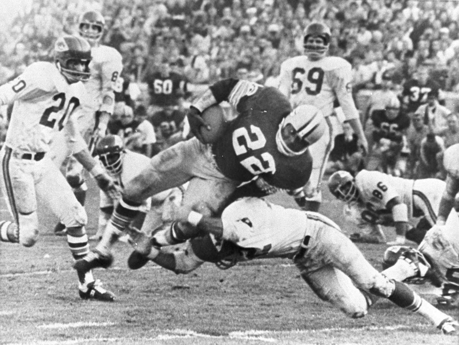 Johnny Robinson, making the tackle, made the Hall in the senior category. He was a defensive star with the Kansas City Chiefs franchise.