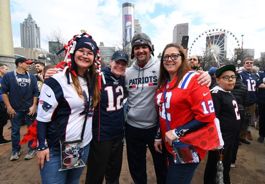 A group of New England Patriots fans gather outside Mercedes-Benz Stadium before Super Bowl LIII.
