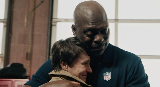 Los Angeles Chargers coach Anthony Lynn is overtaken by emotion as he meets with first responders who helped to save his life as part of an ad for Verizon.