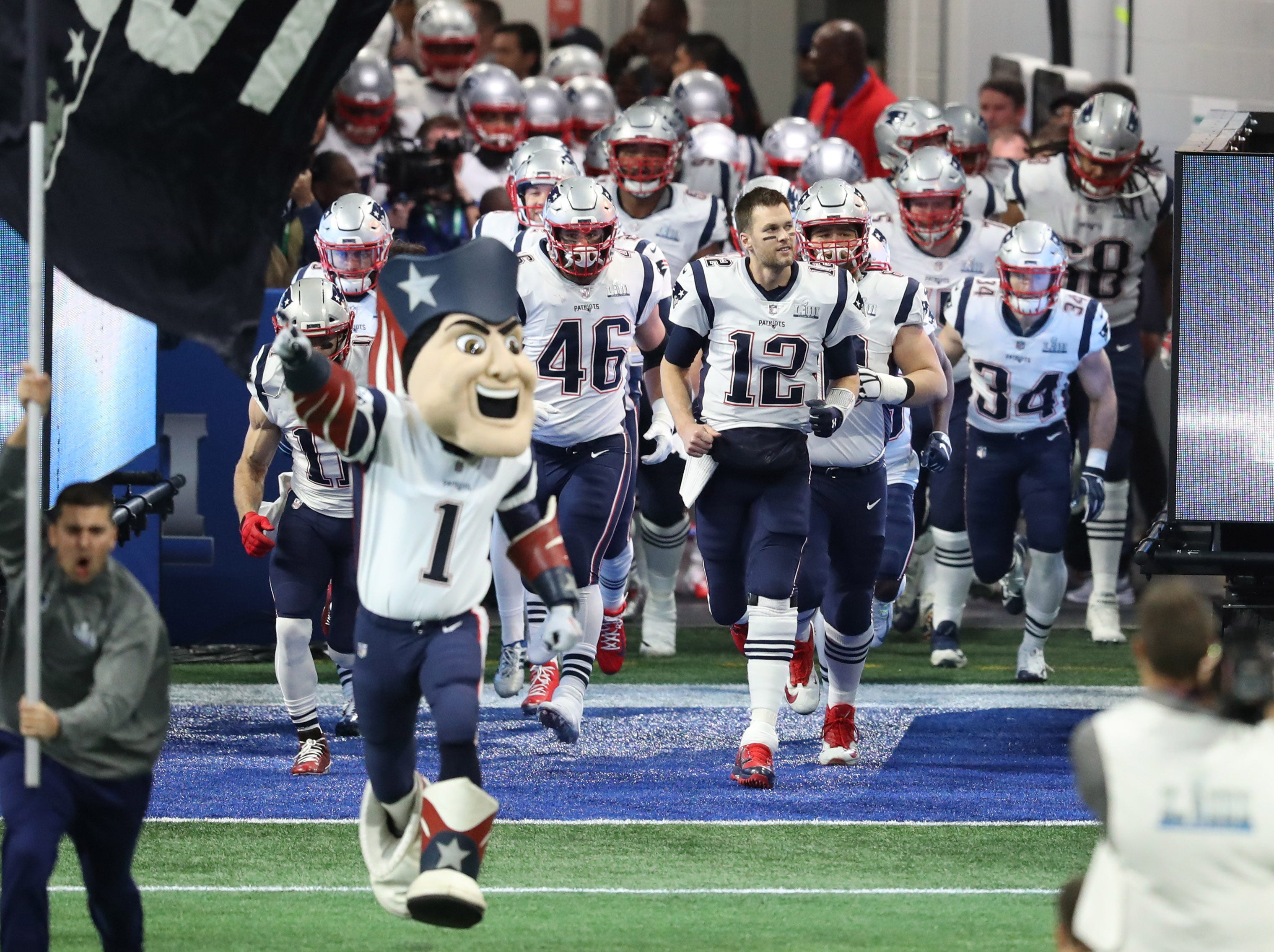 Tom Brady (12) leads the New England Patriots onto the field for Super Bowl LIII at Mercedes-Benz Stadium.