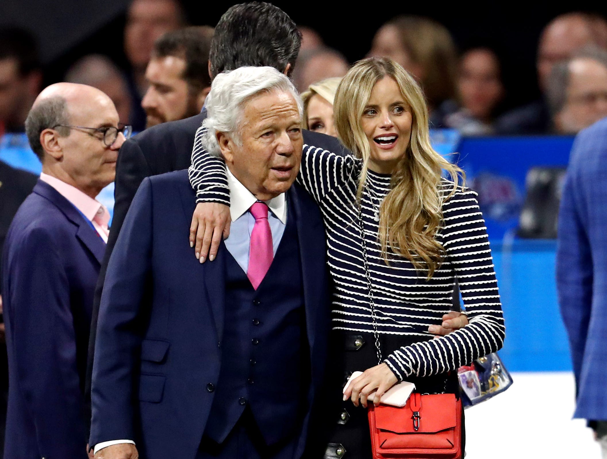 New England Patriots owner Robert Kraft and his wife Ricki Noel Lander on the field at Mercedes-Benz Stadium before Super Bowl LIII.