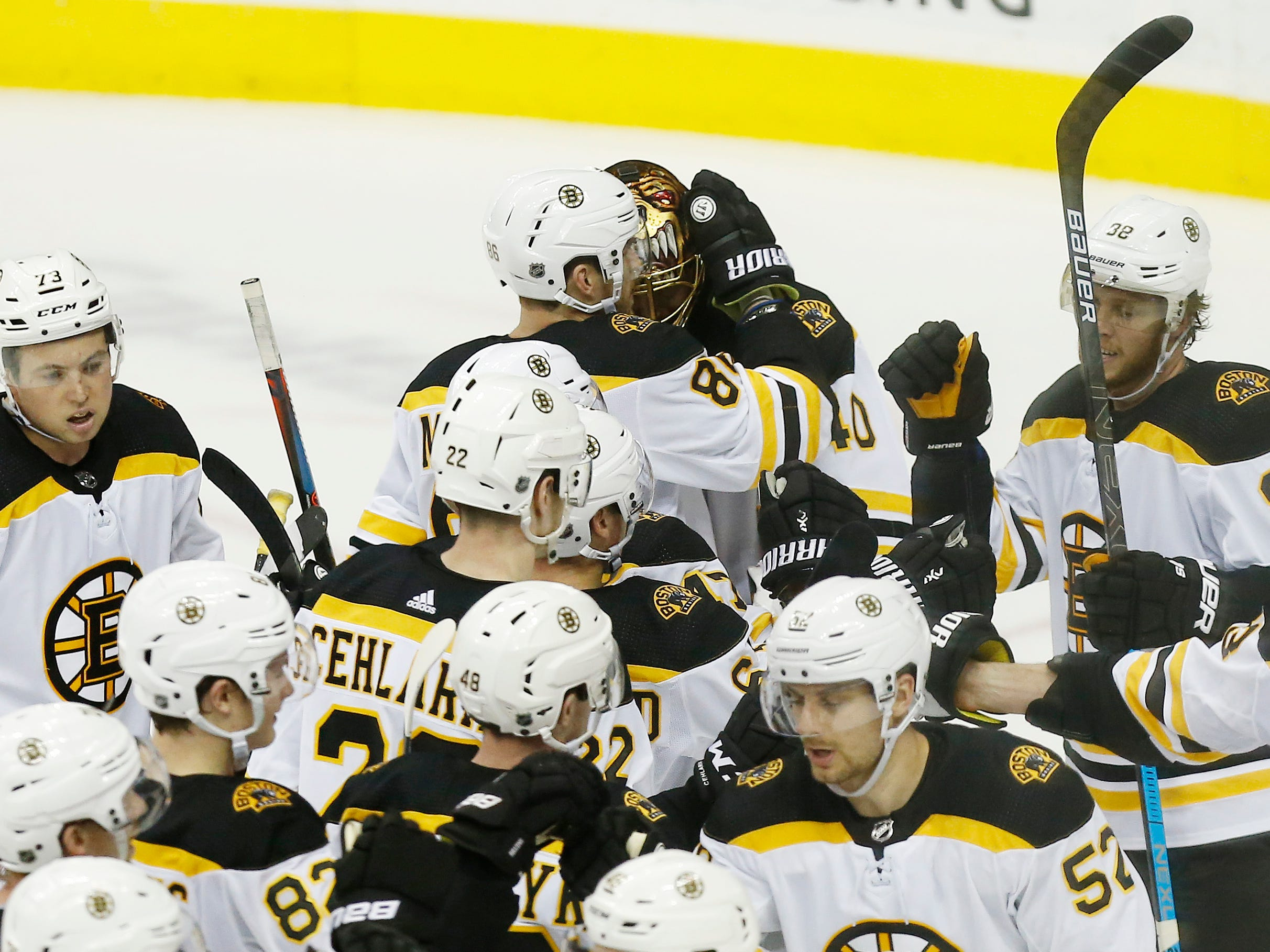 Feb. 3: Boston Bruins goaltender Tuukka Rask (40) celebrates with teammates after a 1-0 victory against the Washington Capitals. It was his 253rd career victory, giving him the franchise record.