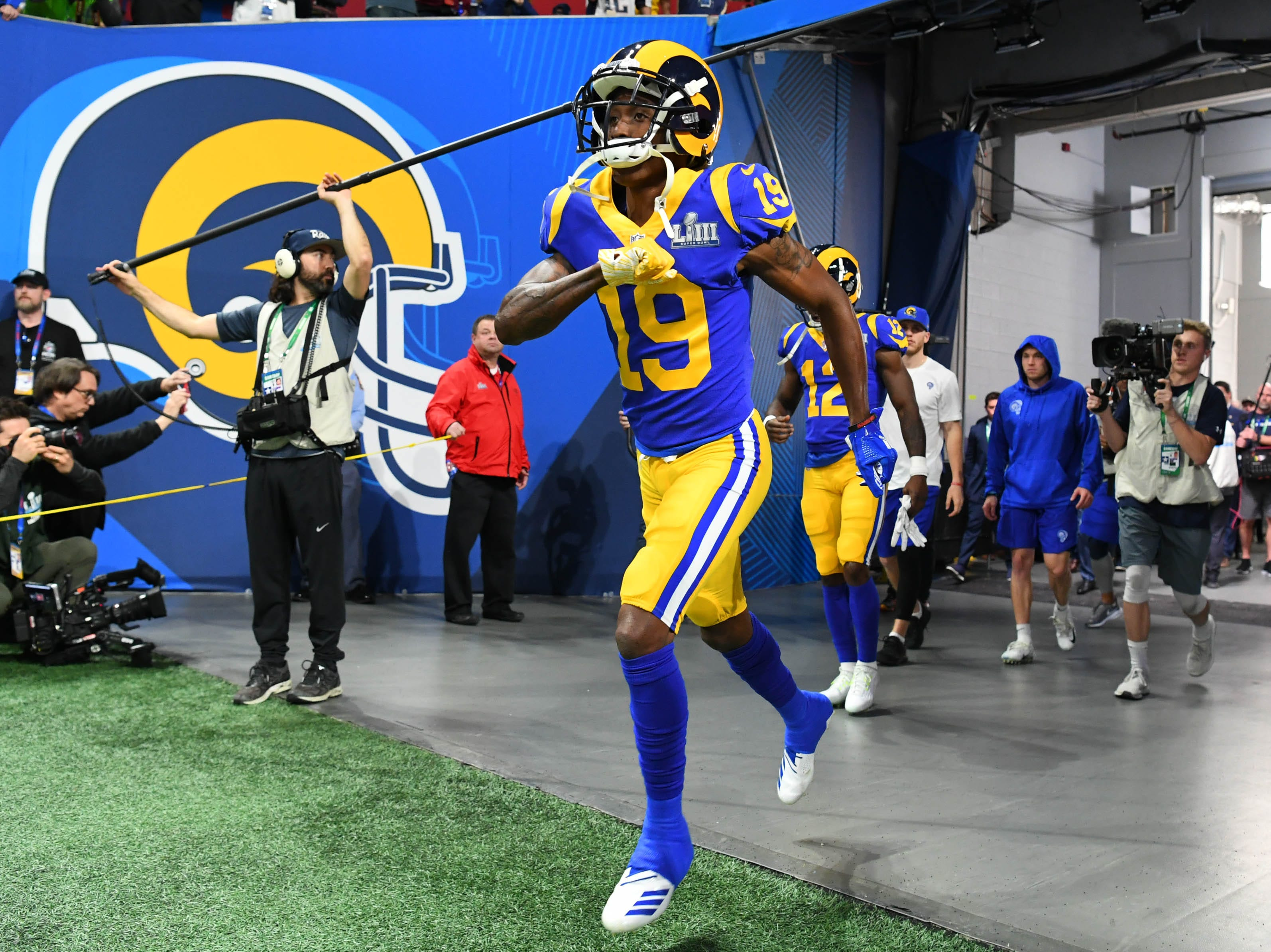 Los Angeles Rams wide receivers JoJo Natson (19) and Brandin Cooks (12) run  onto the field for warm-ups before Super Bowl LIII at Mercedes-Benz Stadium.