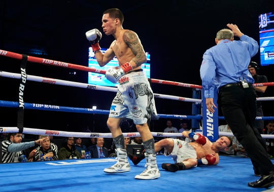 Oscar Valdez, left, celebrates after defeating Carmine Tommasone.