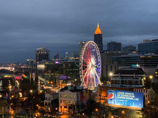 Downtown Atlanta skyline and Skyview Atlanta ferris wheel prior to Super Bowl LIII between the Patriots and Rams.