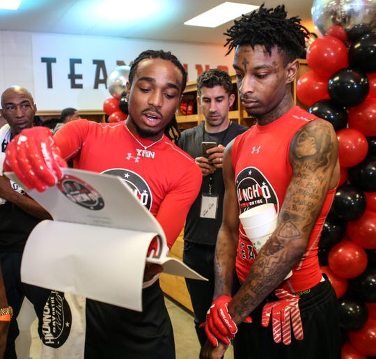 LILBURN, GA - APRIL 01:  (L-R) Quavo and 21 Savage go over plays before the game at Huncho Day at Berkmar High School on April 1, 2018 in Lilburn, Georgia.  (Photo by Thaddaeus McAdams/FilmMagic) ORG XMIT: 775149186 ORIG FILE ID: 940838056