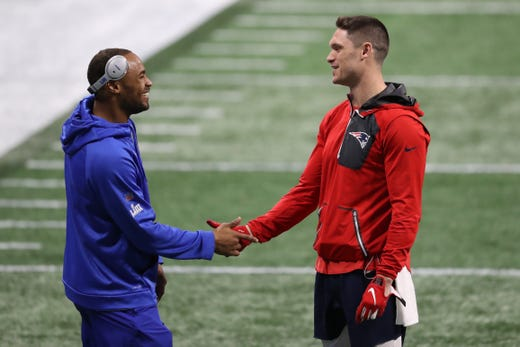 Los Angeles Rams wide receiver Robert Woods. left, and New England Patriots wide receiver Chris Hogan meet during warmups before Super Bowl LIII at Mercedes-Benz Stadium.