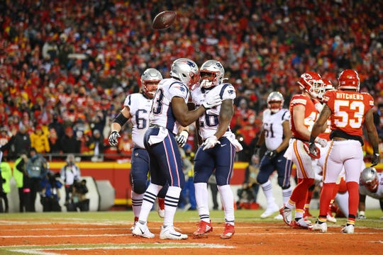 Jan 20, 2019; Kansas City, MO, USA; New England Patriots running back Sony Michel (26) celebrates with Patriots tight end Dwayne Allen (83) after scoring a touchdown against the Kansas City Chiefs during the first quarter of the AFC Championship game at Arrowhead Stadium. Mandatory Credit: Jay Biggerstaff-USA TODAY Sports