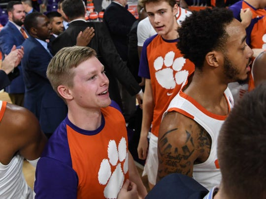 Clemson guard Lyles Davis, stands near Clemson guard Marcquise Reed (2), right, after the team beat Georgia Tech at Littlejohn Coliseum in Clemson Wednesday, January 16, 2019.