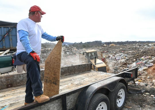 Roy Johnson of Johnson's Karpentry of Tamassee watches as a tractor pushes construction and demolition waste in the open area of the Pickens County Solid Waste Department landfill in Liberty Monday. The area is expected to be full in six to eight months.