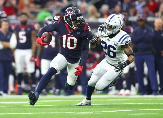 Jan 5, 2019; Houston, TX, USA; Houston Texans wide receiver DeAndre Hopkins (10) is chased by Indianapolis Colts strong safety Clayton Geathers (26)  in the second quarter in a AFC Wild Card playoff football game at NRG Stadium. Mandatory Credit: Mark J. Rebilas-USA TODAY Sports