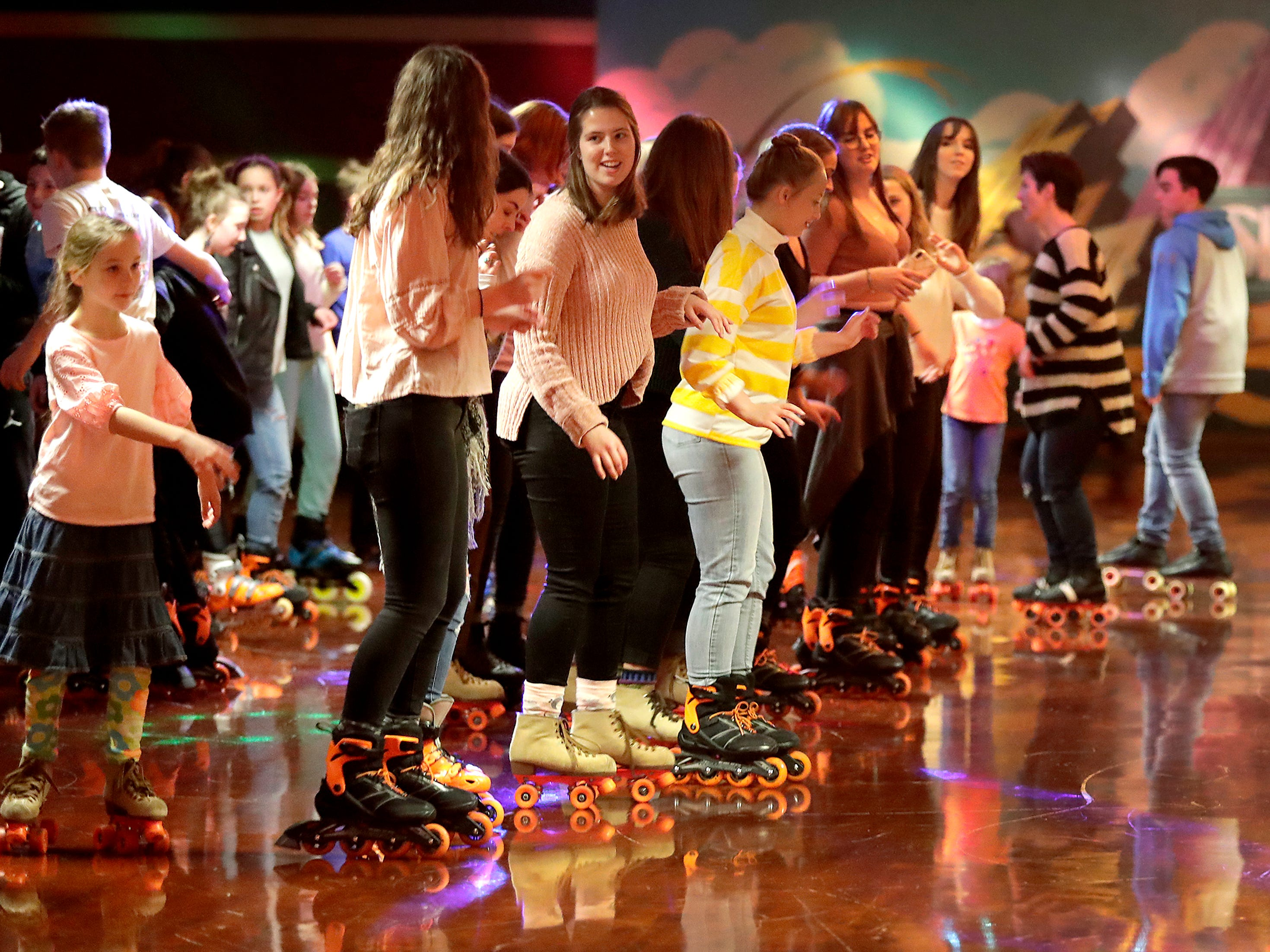 Skaters skate to the Cupid Shuffle at Skate City roller skating rink on Friday, February 2, 2019, in Kimberly, Wis.