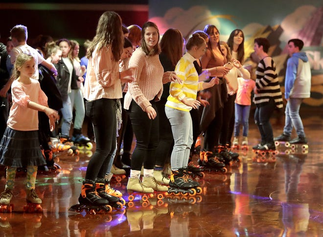 """Skaters move to """"Cupid Shuffle"""" at Skate City roller skating rink in Kimberly earlier this month. Skate City is one of four roller rinks in the Fox Cities."""