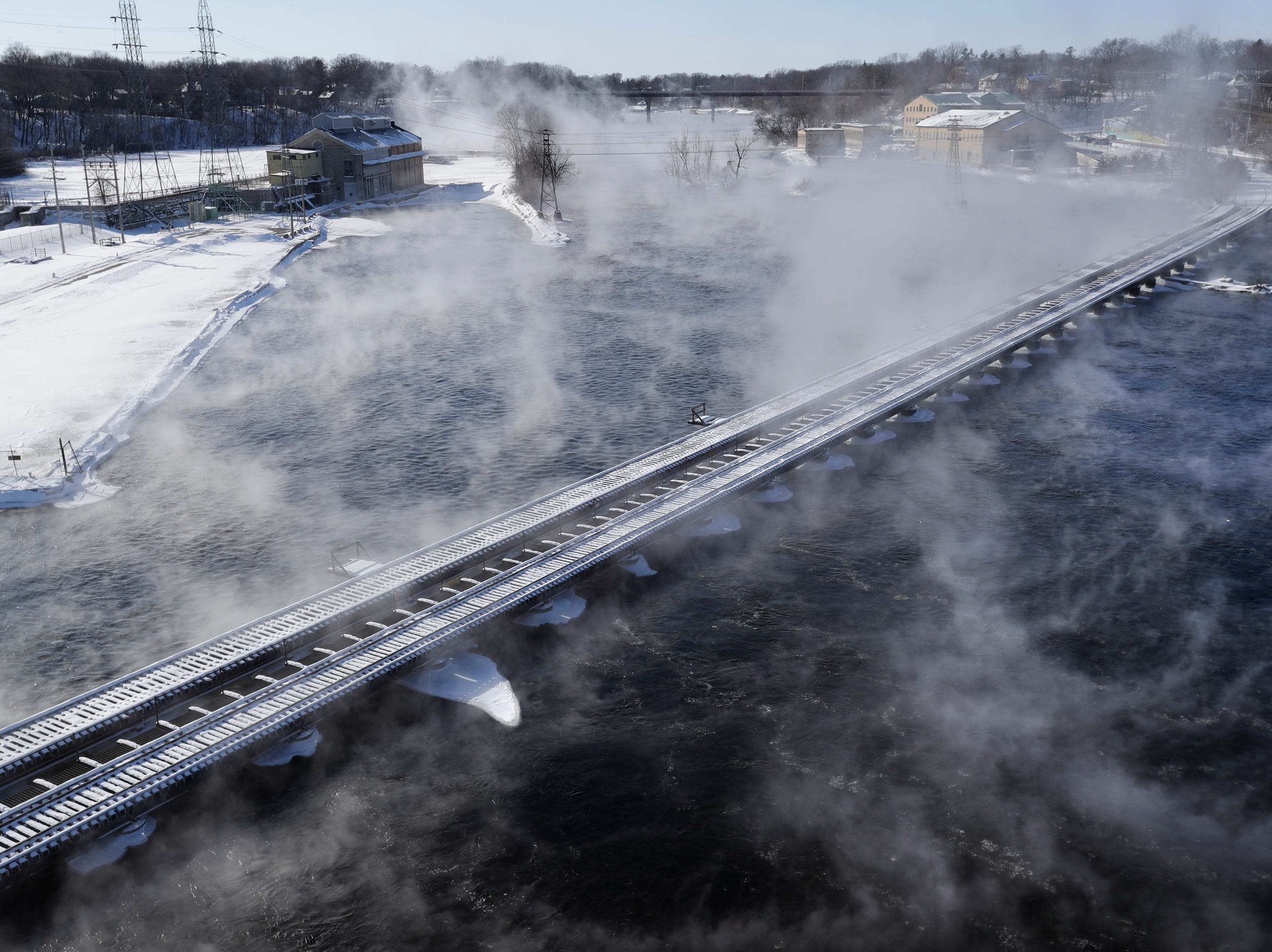 Vapor rises from the Fox River as frigid temperatures and strong winds engulf the area Wednesday, January 30, 2019, in Appleton, Wis. 