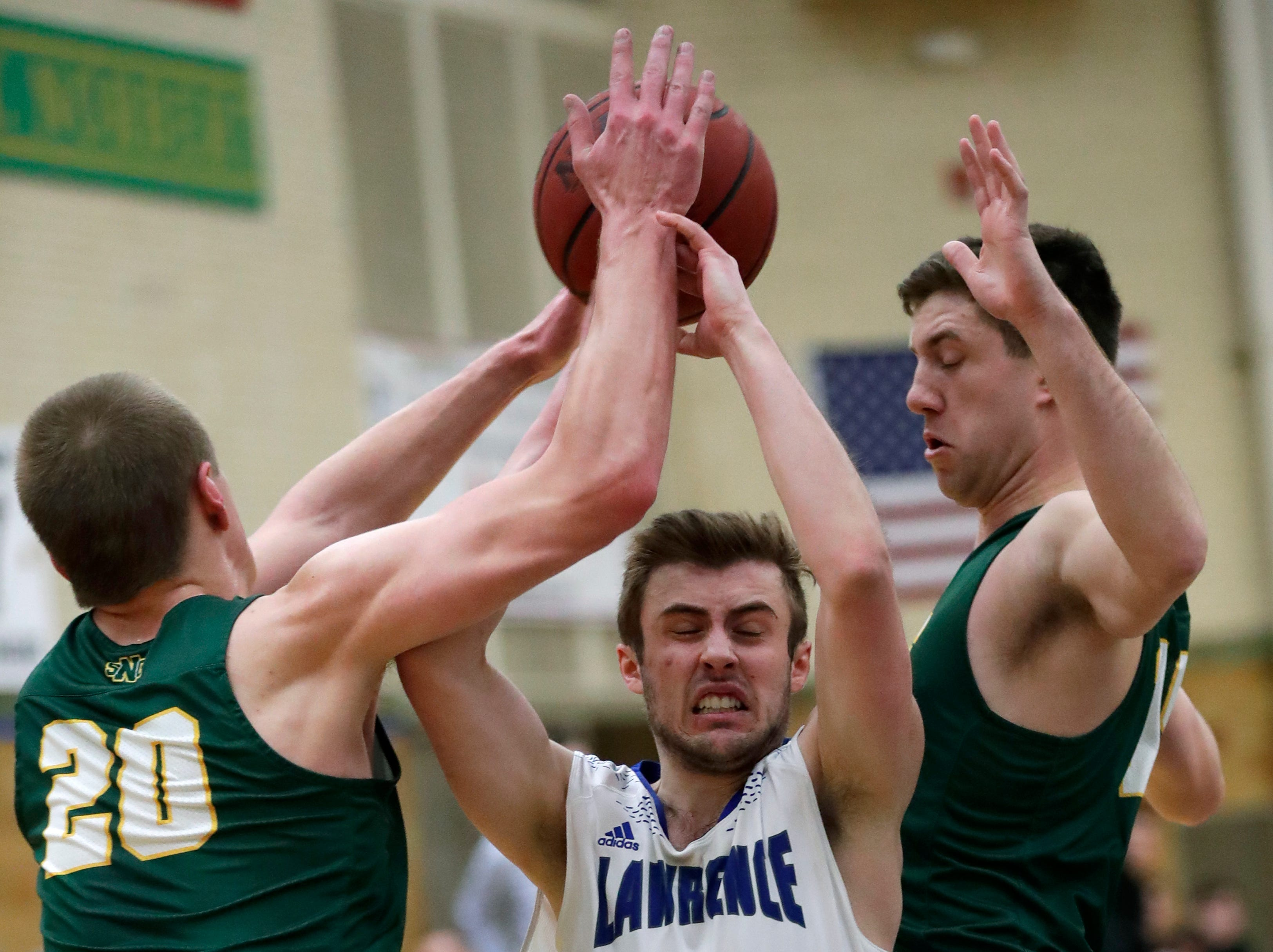St. Norbert College's Nolan Beirne (20) and Matt Lynch (15) defend against Lawrence University's Quinn Fisher (2) during their men's basketball game Thursday, January 31, 2019, at Alexander Gymnasium in Appleton, Wis. 