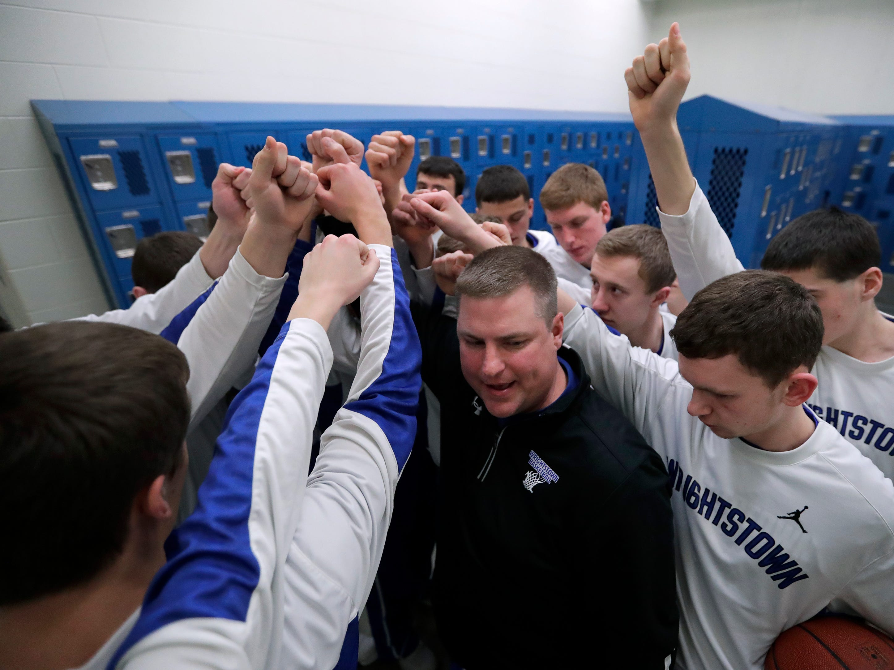 Wrightstown High School's coach Cory Haese, center, brings his team together in the locker room moments before taking to the court against Little Chute High School during their boys basketball game Friday, February 1, 2019, in Little Chute, Wis. 