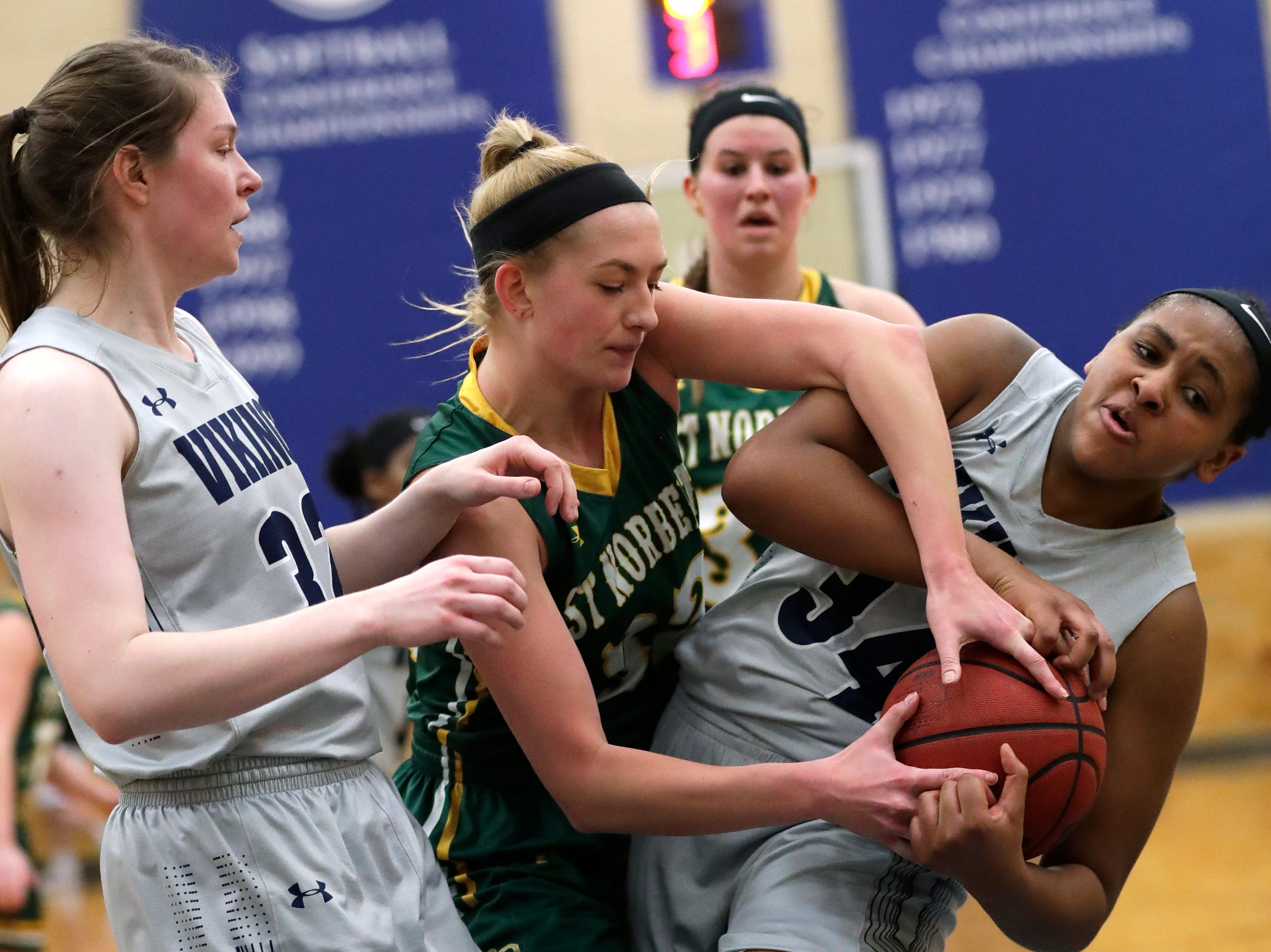 Lawrence University's Kenjya Earl (34) pulls down a rebound against St. Norbert College's Jessica Boerner (32) as Leah Reeves (32) looks to help on the play during their women's basketball game Thursday, January 31, 2019, at Alexander Gymnasium in Appleton, Wis. 