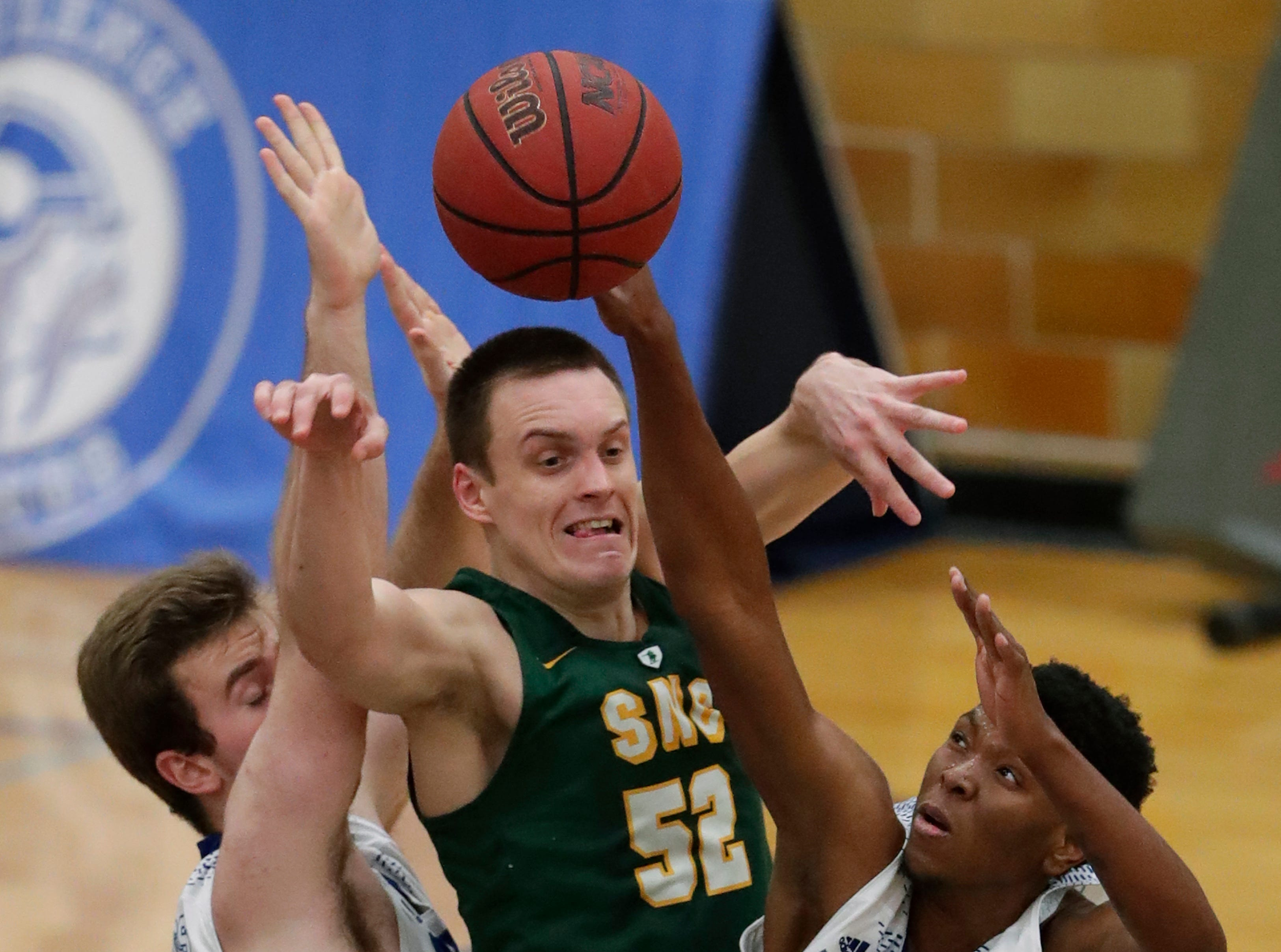 Lawrence University's Joe Duero, left, and Bryce Denham, right, defend against St. Norbert College's Joe Lemon during their men's basketball game Thursday, January 31, 2019, at Alexander Gymnasium in Appleton, Wis. 