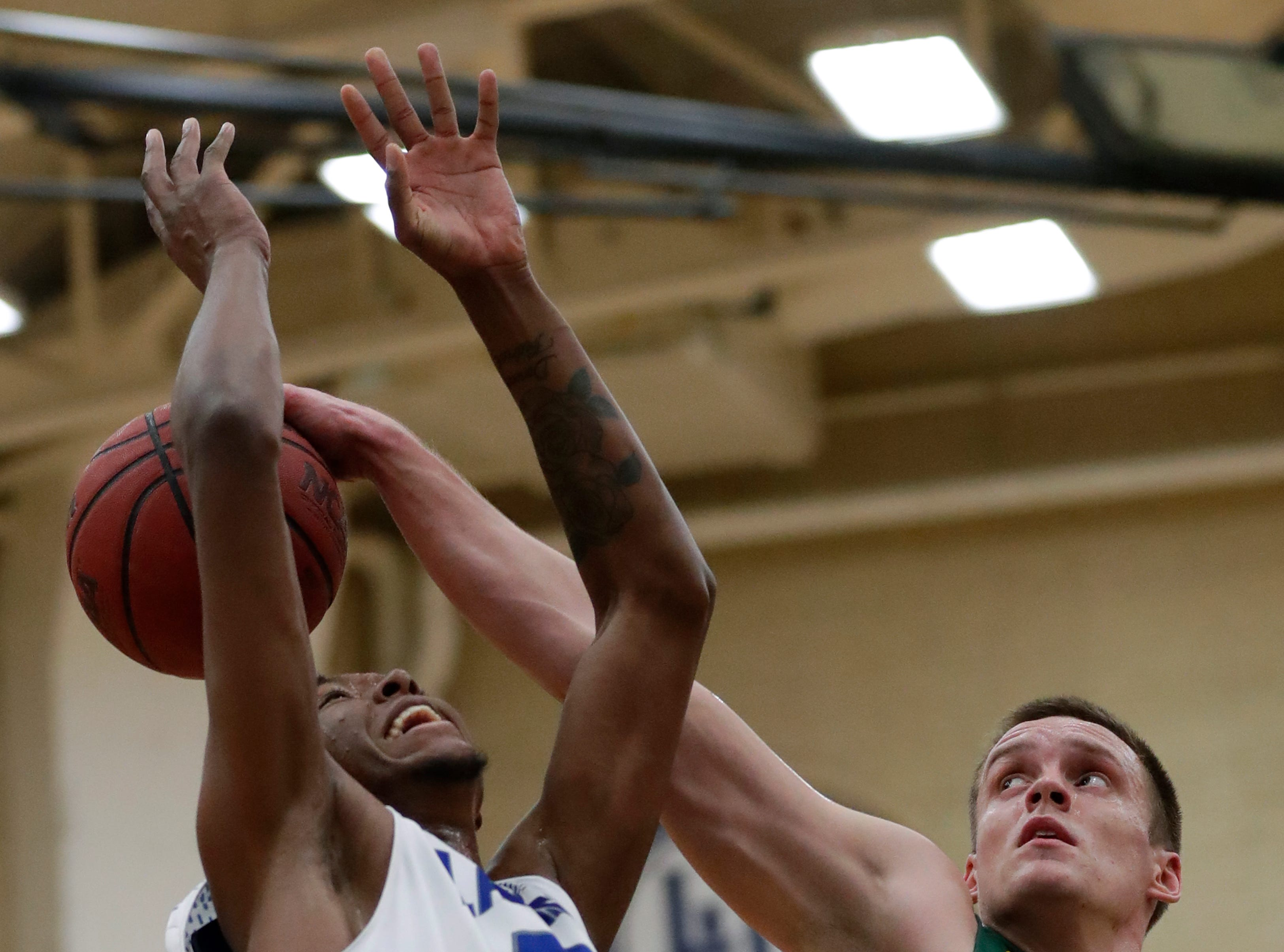 Lawrence University's Bryce Denham (23) is fouled as he puts up a shot against St. Norbert College's Joe Lemon (52) during their men's basketball game Thursday, January 31, 2019, at Alexander Gymnasium in Appleton, Wis. 